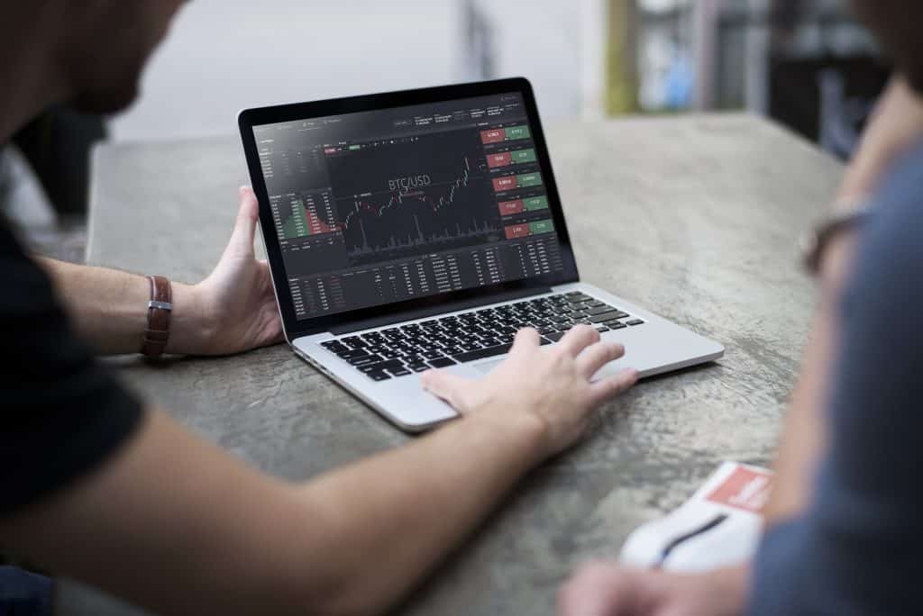 cryptocurrency invesing on laptop